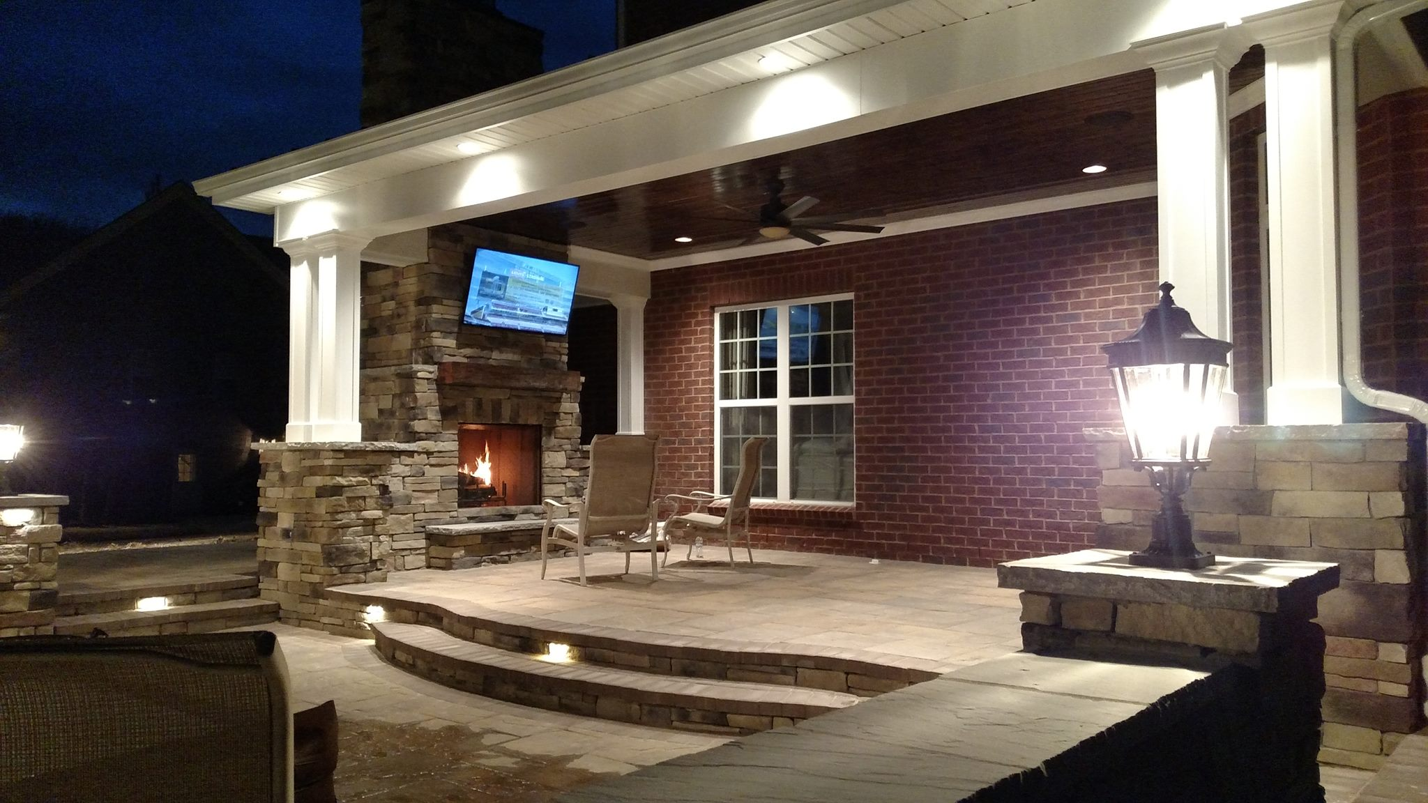 Raised Patio with Covered Porch and Stamped Concrete Signature